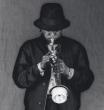 Miles Davis playing his trumpeta